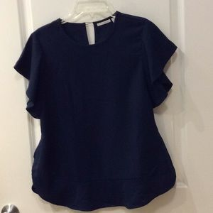 Short sleeved blouse.